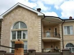 Облицовка фасадов домов и зданий травертином