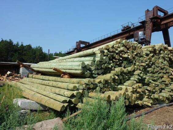 Столбы деревянные опоры лэп улица магистральная жби
