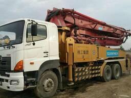 Услуги автобетононасоса 42 метра в Алматы .