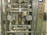 Вертикальная упаковочная машина с формирователем пакета